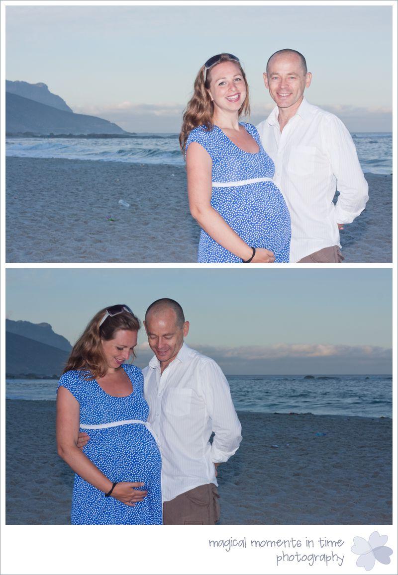 pregnant couple at sunrise on the beach