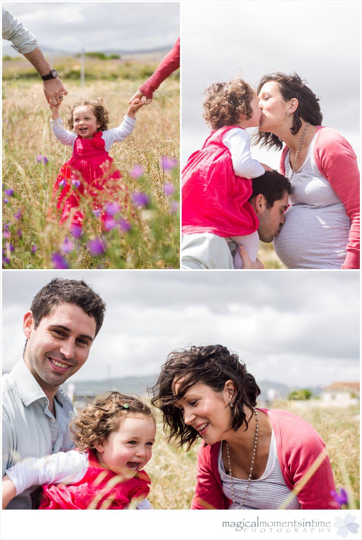 family photo shoot in field celebrating pregnancy