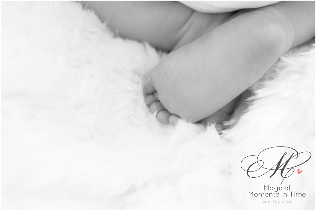 black and white newborn little toes and legs